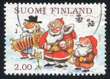 Kerstman en Gnoom die Muzikale Instrumenten spelen royalty-vrije stock foto