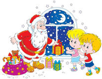 Kerstman en jonge geitjes Royalty-vrije Stock Foto's