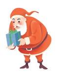 Kerstman en Kerstmisgift Stock Fotografie