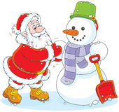 Kerstman en Sneeuwman Stock Afbeelding