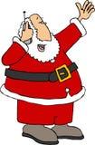 Kerstman gebruikend een celtelefoon Stock Foto's
