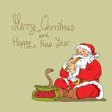 Kerstman Klaus en slang Stock Foto's