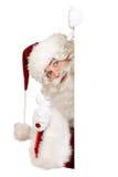Kerstman met duim op banner Stock Afbeeldingen