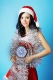 Kerstman, met een klok stock afbeeldingen