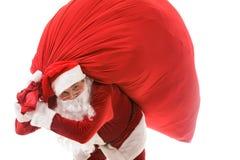 Kerstman met giften stock afbeelding