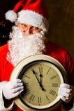 Kerstman met klok Stock Fotografie
