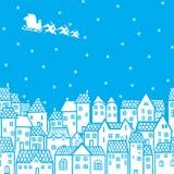 Kerstman over de stad Stock Foto