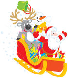 Kerstman, Rendier en Sneeuwman Stock Foto