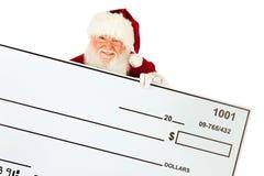 Kerstman: Santa Claus Holding Oversized Check Royalty-vrije Stock Fotografie