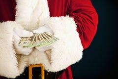 Kerstman: Santa Holding Fanned Out Cash Royalty-vrije Stock Fotografie