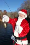 Kerstman Trots van Zijn Grote Vangst Stock Afbeeldingen