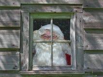 Kerstman in workshopvenster Stock Foto
