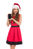 Kerstmanmeisje die mobiele telefoon voorstellen Stock Afbeelding