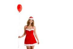 Kerstmanmeisje die zich met rode ballon bevinden Stock Foto's