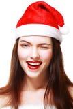 Kerstmanmeisje het knipogen Royalty-vrije Stock Foto's
