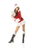 Kerstmanvrouw die een klem van poetsmiddelgeld houden royalty-vrije stock fotografie