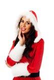 Kerstmanvrouw wat betreft haar kin Stock Fotografie