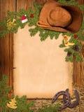 Kerstmis Amerikaanse westelijke achtergrond met cowboyhoed en oude pa Stock Fotografie