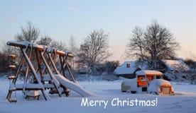 Kerstmis bij kinderen` s speelplaats Stock Foto's