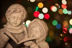 Kerstmis Carolers met Horizontale Lichten - royalty-vrije stock afbeelding