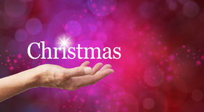 Kerstmis in de palm van uw hand Royalty-vrije Stock Afbeelding
