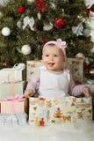 Kerstmis en babymeisje Stock Foto