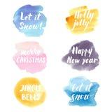 Kerstmis en nieuwe jaar moderne die het van letters voorzien uitdrukkingen op watercolo wordt geplaatst vector illustratie