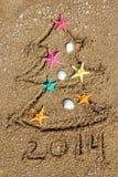 Kerstmis en Nieuwjaar 2014 op het strand Stock Foto
