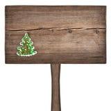 Kerstmis groene spar op een houten raad Stock Afbeeldingen