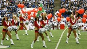 Kerstmis Halftime van Cheerleaders van cowboys toont Royalty-vrije Stock Afbeeldingen
