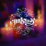 Kerstmis het glanzende van letters voorzien met patroon op vage achtergrond Royalty-vrije Stock Foto's