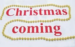 Kerstmis het komende trekken op wit Royalty-vrije Stock Foto's