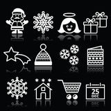 Kerstmis, Kerstmis viert witte die pictogrammen op zwarte worden geplaatst Stock Afbeeldingen