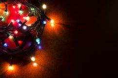Kerstmis kleurrijke opvlammende lichten Stock Afbeelding