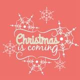 Kerstmis is komende kaart met sneeuwvlokornament Royalty-vrije Stock Foto