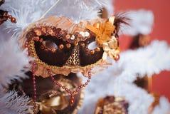 Kerstmis licht binnenland met masker Stock Foto's