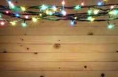 Kerstmis lichte pensionair op houten achtergrond royalty-vrije stock foto