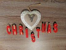 Kerstmis met decoratie wordt geschreven die Stock Foto