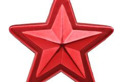 Kerstmis & Nieuwjaar rode ster tegen witte achtergrond stock foto