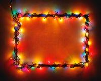 Kerstmis steekt veelkleurig kader op sneeuwachtergrond aan stock fotografie