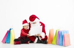 Kerstmis van de Kerstman en van het kind het Online Winkelen Stock Foto
