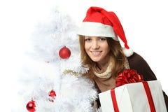 Kerstmis - vrouw in santahoed Stock Afbeelding