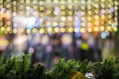 Kerstmisachtergrond met bokehlicht Stock Afbeeldingen