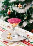 Kerstmisachtergrond met de wintersalade royalty-vrije stock afbeeldingen