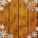 Kerstmisachtergrond met document sneeuwvlokken op houten planken royalty-vrije illustratie