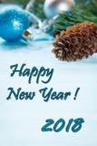 Kerstmisachtergrond met Kerstmisspeelgoed en builen Exemplaar ruimte selectieve nadruk het Inschrijvings Gelukkige Nieuwjaar 2018 Royalty-vrije Stock Foto