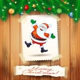 Kerstmisachtergrond met prentbriefkaar en gelukkige Kerstman Stock Foto