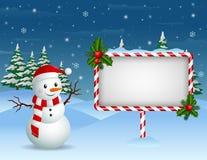 Kerstmisachtergrond met Sneeuwman en leeg teken Stock Foto