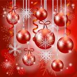 Kerstmisachtergrond met snuisterijen in rood Royalty-vrije Stock Foto's