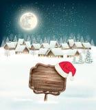 Kerstmisachtergrond van de de wintervakantie met een dorp Royalty-vrije Stock Foto's